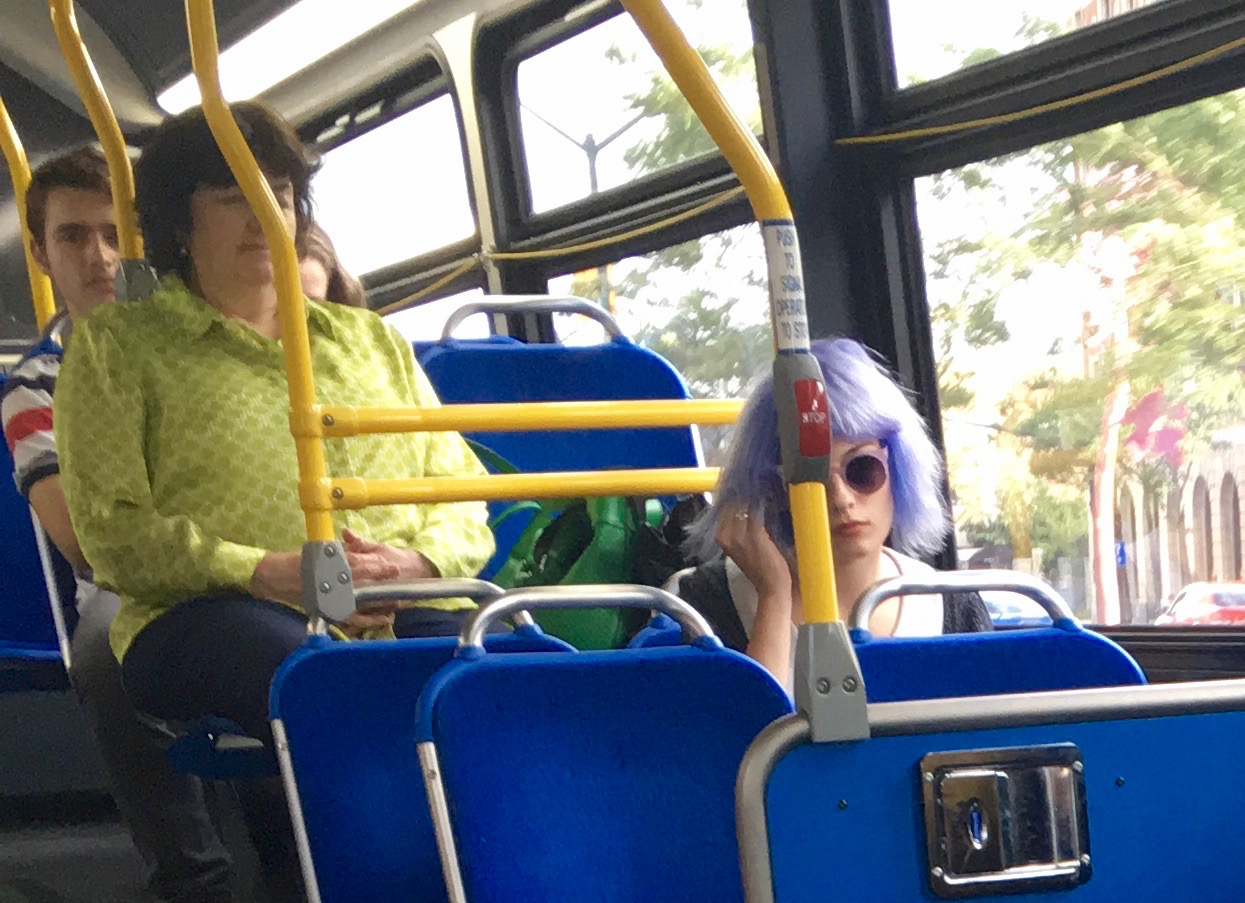 Girl with sunglasses and blue hair with lady in green